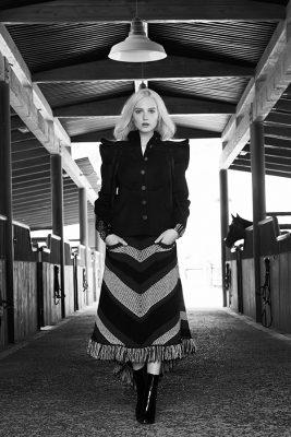 Black wool jacket, multi-coloured wool skirt, black patent calfskin boots and multi-coloured bracelets, CHANEL