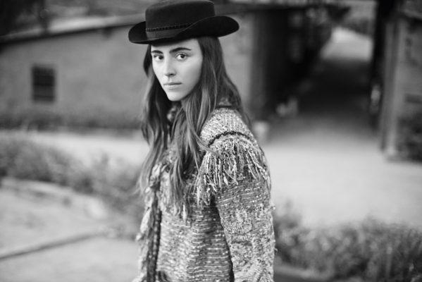 Multi-coloured tweed jacket and black velvet hat, CHANE