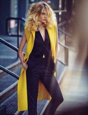 Bright yellow double-breasted sleeveless wool coat and black three-piece flannel suit, DIOR