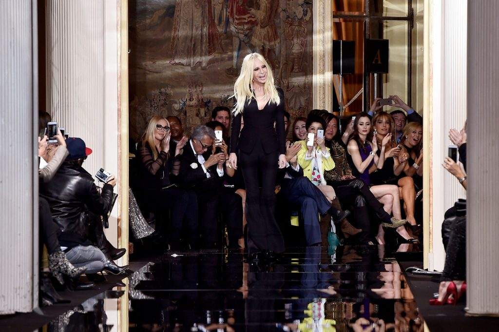 Fashion designer Donatella Versace acknowledges the applause of the audience after the Versace show as part of Paris Fashion Week Haute Couture Spring/Summer 2015 (Photo by Pascal Le Segretain/Getty Images)