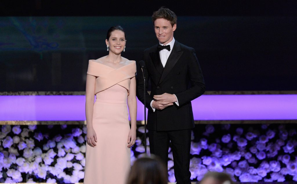 Felicity Jones and Eddie Redmayne onstage at the 21st Annual Screen Actors Guild Awards, 2015. Photography by Kevork Djansezian/Getty Images