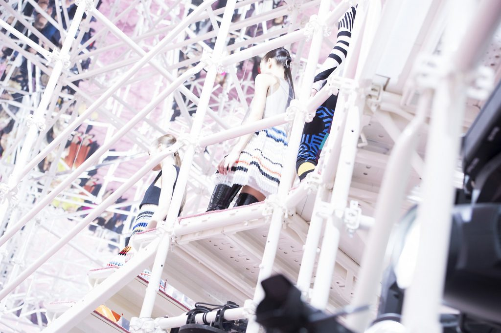 Models scale the scaffolding (Photo courtesy of GoRunway)