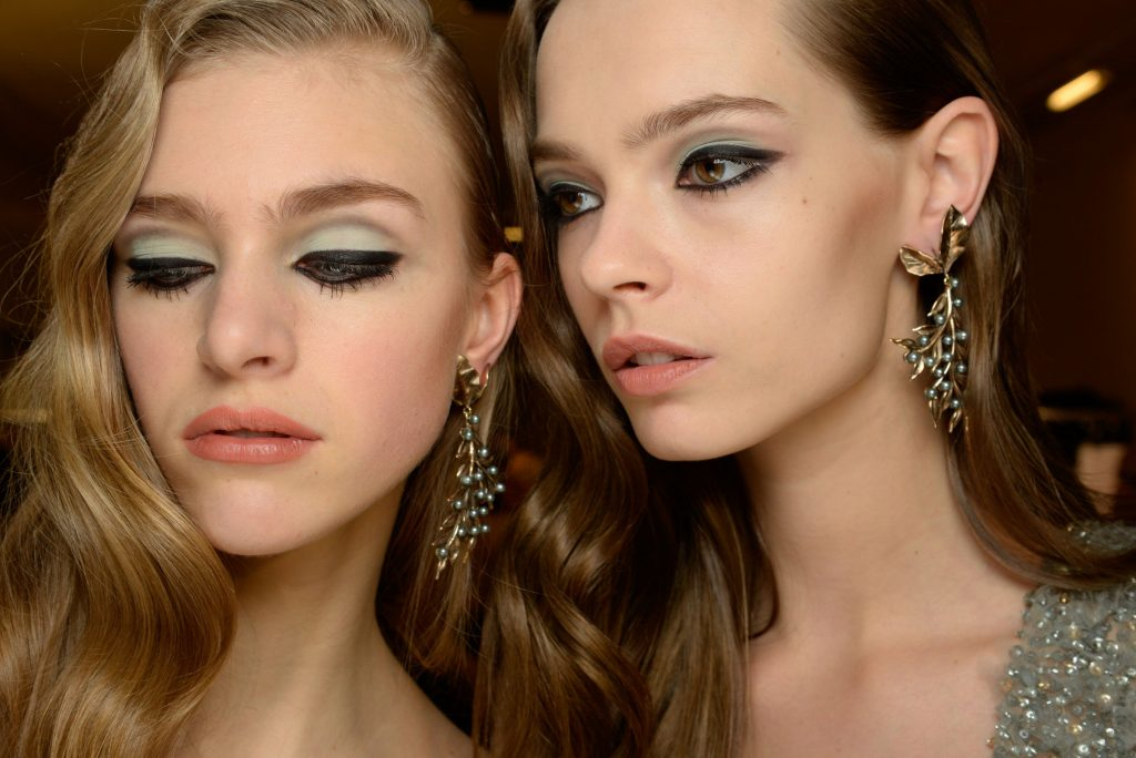 Bold eyes are pared with clear skin and coral lips at Elie Saab (Photo courtesy of GoRunway)