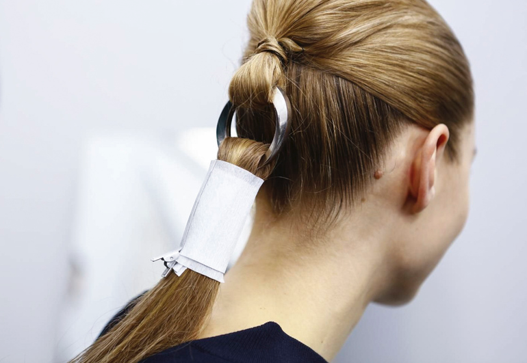 A Dior carabiner was used to secure model's ponytails (Photo Courtesy of NowFashion)