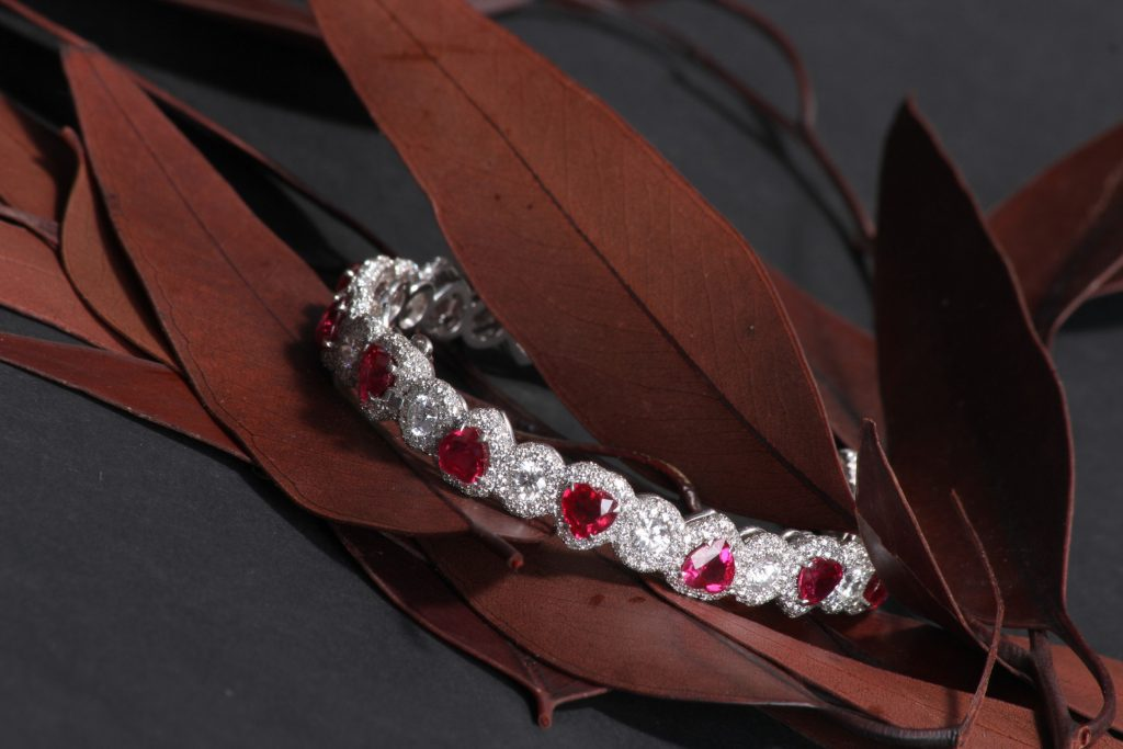 Bracelet with heart rubies, round white diamonds with round white diamond micro-set surround, DAVID MORRIS
