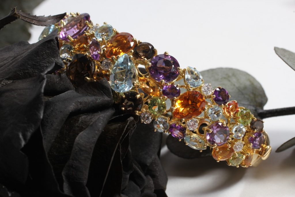 Shanghai bangle with diamonds, ruby, amethyst, citrine, blue topaz, peridot and orange quartz, set on yellow gold, ROBERTO COIN AT DAMAS