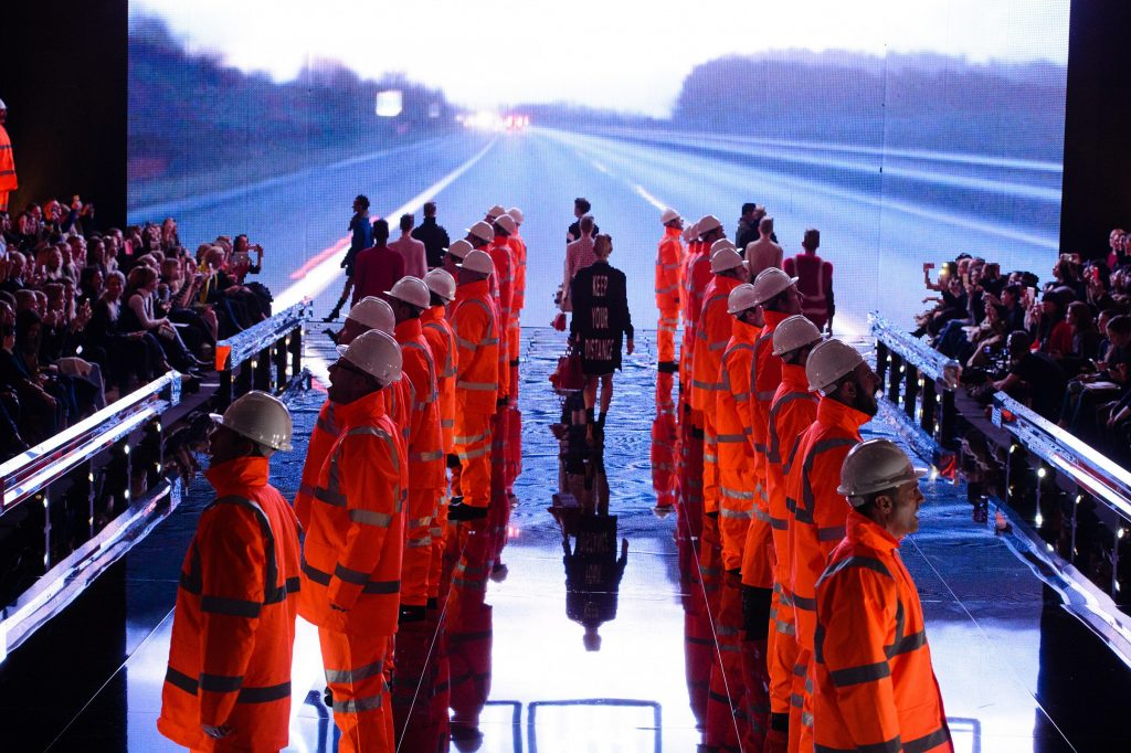 Anya Hindmarch's singing motorway workers serenade the audience in high-vis at her AW15 show.