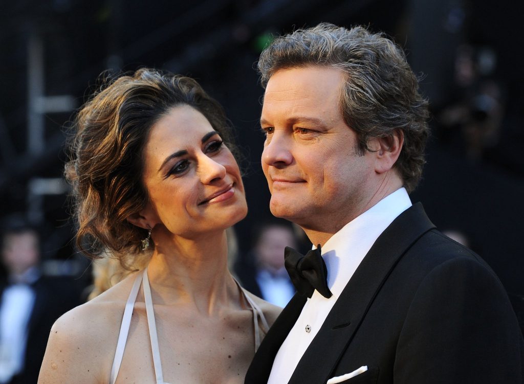 Colin Firth with Livia Firth wearing a recycled dress by Gary Harvey at The Oscars 2014, Image Courtesy of Frazer Harrison at Getty Images