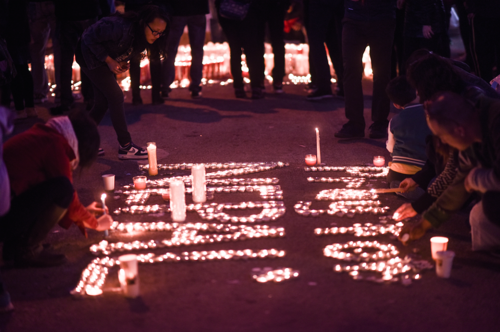 Candles are lit in New York, Prabal Gurung's hometown, during a vigil for the victims of the earthquake