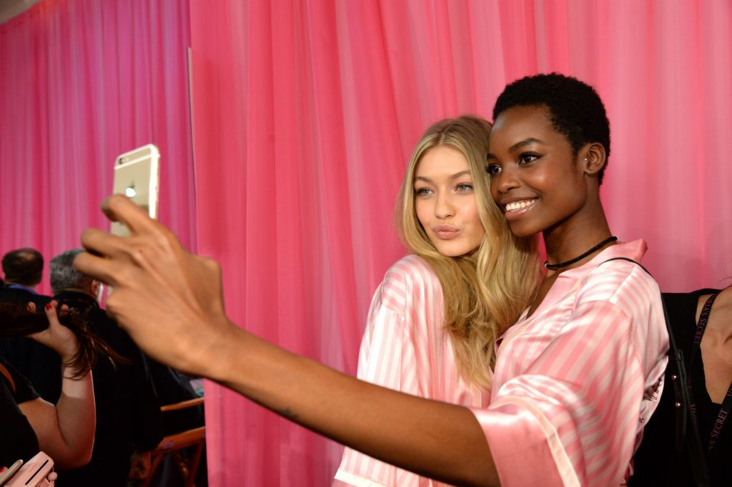 Gigi Hadid and Maria Borges get ready backstage before the 2015 Victoria's Secret Fashion Show at Lexington Armory on November 10 in New York City. Image courtesy of Getty.
