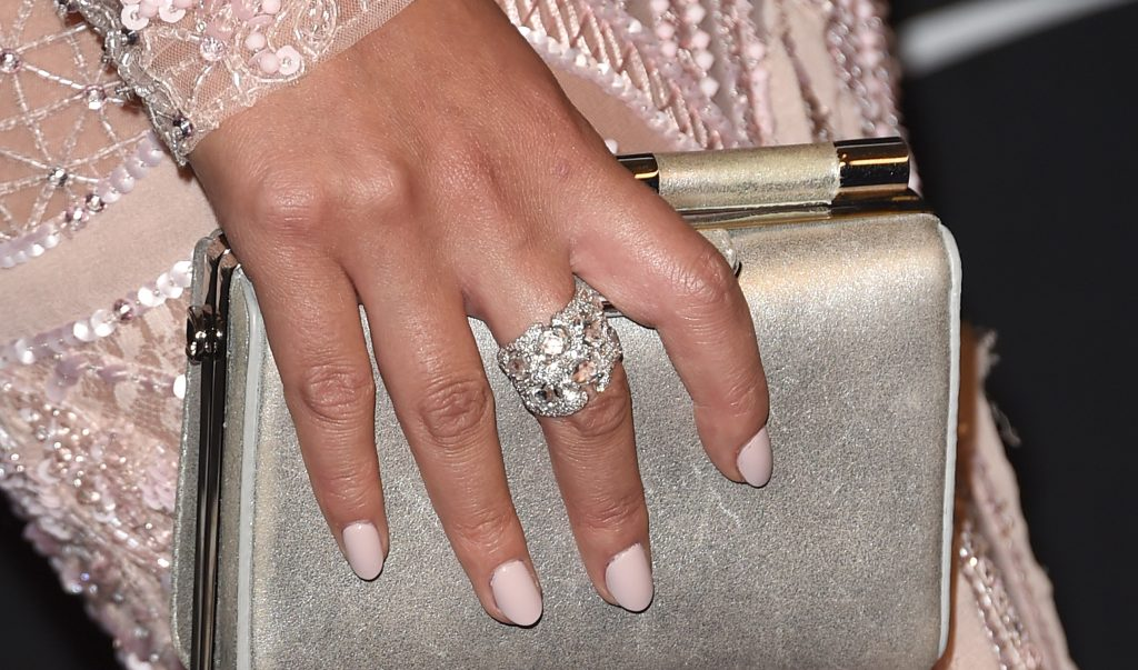 Chrissy Teigen wears a Suzanne Kalan ring at this year's Golden Globes. Getty Images.
