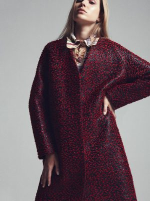 Coat, BALENCIAGA | Shirt, CHLOÉ | 18K rose gold necklace with red rubies and diamonds, LA MARQUISE JEWELLER