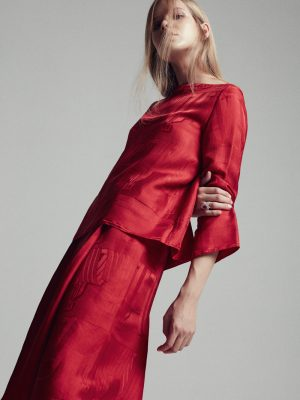 Top and skirt, HERMÈS | Red ruby and diamond ring, LA MARQUISE JEWELLERY