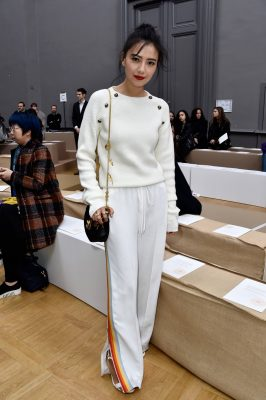 5. Team with Traditional Accessories. Remember that you're not 'working from home'. A structured camel jacket thrown over the shoulders and a classic handbag bring this look together
