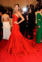 At the 2011 Met Gala honouring Alexander McQueen, Gisele wore the late designer's glorious Fall 2005 red fish-tail gown.