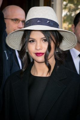 Street style-savvy Selena Gomez is spotted in France with lacquered burgundy lips, a statement shade perfect for cooler months and evening events. Wear with textured, heavier fabrics in navy or a deep emerald.