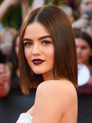 Pretty Little Liars actress Lucy Hale glittered in a silver mini-dress while in Toronto this June, which she paired with pointy-toed silver pumps and a moody blue-violet lipstick. This shade looks great with her bold, full brows.
