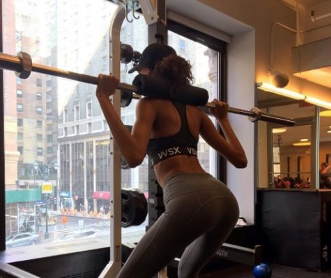 Cindy Bruna does weighted squats.