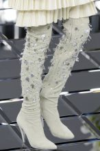 The Summer Boots - Chanel: Soft suede boots became relevant for the season when paired with a light palette and the soft and breezy fabrics of Spring/Summer. Definitive details came in the form of scattered beading and jewels stitched all over to catch the eye and add a sense of glamour