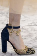 The Bejewelled Heels – Elie Saab: A palette of gold and navy might sound heavy for summer but Elie Saab's cage-front sandals are delicate enough for the season's sensibilities. Delicate ankle chains with floral motifs make them all the mor