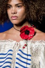 The Floral Necklace – Jean Paul Gaultier: Powerful outsized poppies poked out amongst Jean Paul Gaultier's collection. Worn loosely around the neck, the bright red blooms make a refreshing change from the light and delicate florals we have seen in past seasons