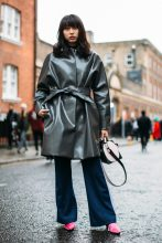 A glossy grey coat pairs perfectly with navy flares and pink mules.