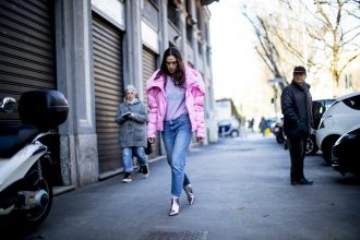 A candy pink puffer, vintage-style denim and silver ankle boots channel 80's nostalgia.