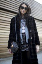 A high-shine vinyl skirt and denim varsity jacket toughen up a tactile fur coat.