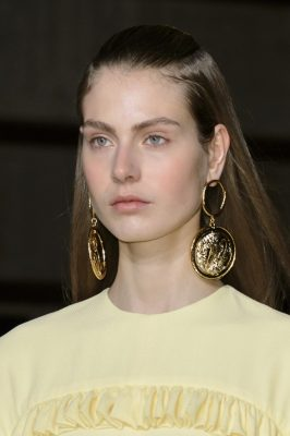 Statement earrings in luxurious gold resembled medallions that worked to elevate prairie dresses.