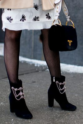 For a contemporary take on the ankle boot, seek out styles with metal hardware and embellishments.