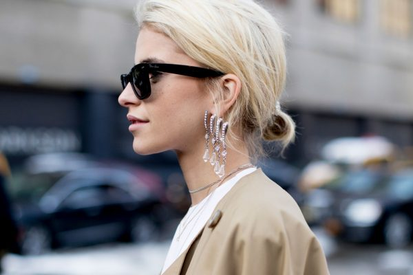 Use statement chandelier earrings to bring understated glamour to a pared back look.