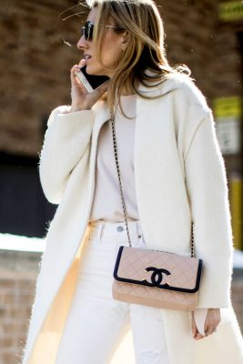 For a look that's both stylish and feminine, pair a pastel bag with an all white ensemble.