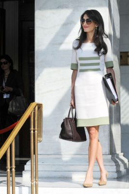 When: October 14, 2014 | The mother-to-be looked at ease during a work trip to Athens, where she sported a Camillo Bona summer dress, with a mahogany structured handbag.