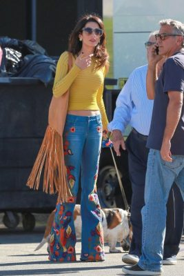 When: October 20, 2016 | Channelling some serious Summer of Love vibes, Alice + Olivia Sixties-styled flared jeans are paired with a long-sleeved, modest mustard ribbed jumper.