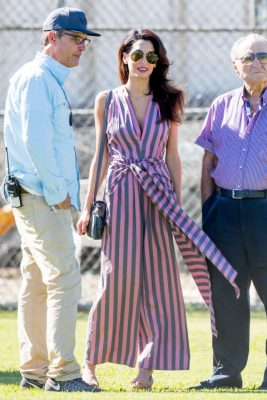 When: October 21, 2016 | While visiting her husband, George, on the set of his latest film, in Los Angeles, the brunette donned a loose fitting, V-neck, lavender-striped Tome jumpsuit.