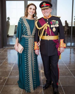 June 2016 | Pictured here alongside her husband during the Great Arab Revolt Centennial celebration, Queen Rania wears a magnificently decadent Etro teal gown with delicate gold embroidery. The whole ensemble is lifted with minimalist, yet opulent, jewellery and an embellished gilded clutch.