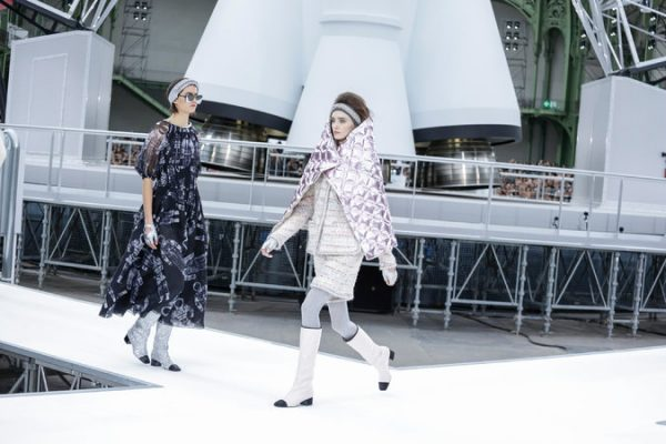 Chanel: Karl Lagerfeld transformed the Grand Palais into the Chanel space centre, transporting his guests into circa-Sixties outer space.  Models weaved their way around the runway in chunky silver moon boots, foil wrapped outerwear and clinical whites that alluded to astronaut suits.