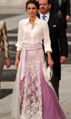 When: May 2004 | Bejewelled, silver creations dangle from Queen Rania's ears and neck, as she attends Spanish Crown prince Felipe and Queen Letizia's wedding in Madrid. A white mini-clutch accompanies a tailored, ivory-hued silk blouse and lavender, lace skirt.