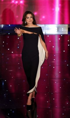 February 2010 | Never one to disappoint, the Jordanian beauty strode onto the stage during the 60th Sanremo Song Festival in Italy to a plethora of cheers. Six-inch heels were worn with a jet-black, tight-fitting maxi dress complete with a sweet-heart neckline. Her black cape, which featured a plush, white lining took an otherwise modest look to a whole new level.