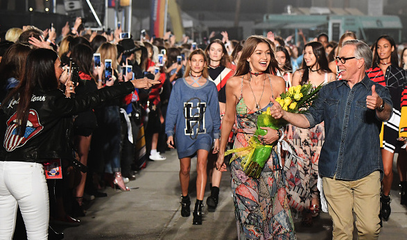 Gigi Hadid and Tommy Hilfiger walk the runway during the brand's spring/summer17 show staged in Los Angeles.