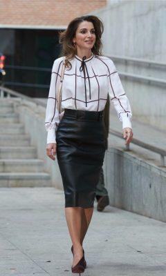 November 2015 | While out and about in Madrid, the brunette catches the eyes of photographers who snap her in a high-waisted, leather pencil skirt, worn with a white and black long-sleeved blouse. Add a dash of colour to a similar outfit with a bold, statement clutch.