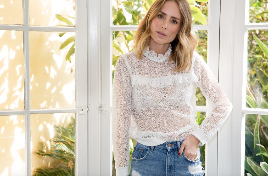 Bing wears lace sweatshirt and vintage wash jeans from Anine Bing. Photographed by William Callan