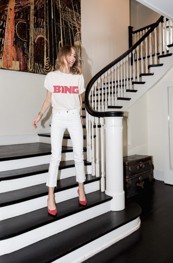 Bing wears vintage Bing tee, white jeans and Elly pumps in red suede from Anine Bing. Photographed by William Callan