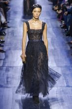 36a455a9684 Beautiful gowns in midnight blue were embroidered with lacy black flowers