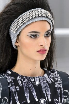 Chanel: The collection's Sixties futurism, spilled over into hair and beauty with metallic eyelids and bouffant blow-dries adorned with embellished headbands.