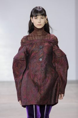 Ellery: Continuing to impress season-upon-season, the brand's stamp of architectural construction endured for fall. A palette of burgundy, turmeric, and black with a touch of tie-dye was underpinned with decadent detailing in the form of gilded fastenings and accessories.