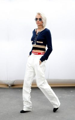 Chanel: Cara Delevingne arrived at the show wearing a grown-up sporty look that signalled fashion's shift to the streets. Pairing Supreme shorts and white trousers with a Chanel cardigan and a fresh platinum crop, the model sat alongside fellow brand ambassadors Pharrell Williams and Lily-Rose Depp on the front row.