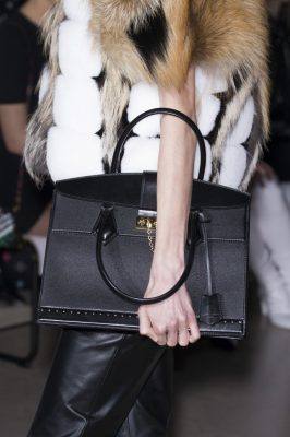 Louis Vuitton: The accessory of the season came in the form of Louis Vuitton's structured handbag. Black matte leather, and discreet hardware studs make this the season's edgy new staple.