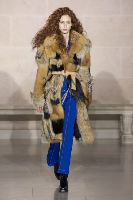 Louis Vuitton: Silky metallics rubbed against shaggy shearling while a plethora of prints illustrated Seventies silhouettes under the illustrious Louvre pyramid.