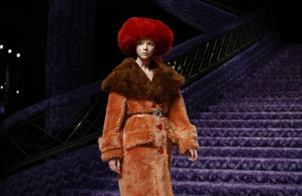 Miu Miu: In a powerful and tactile display, the brand covered the the entire grand staircase of the Palais d'Iéna in sumptuous purple faux fur.